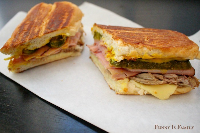 This Crockpot Cuban Sandwich recipe is out of this world! The slow cooked pork shoulder pairs perfectly with ham, pickles, cheese, and mustard for a meal you won't soon forget!