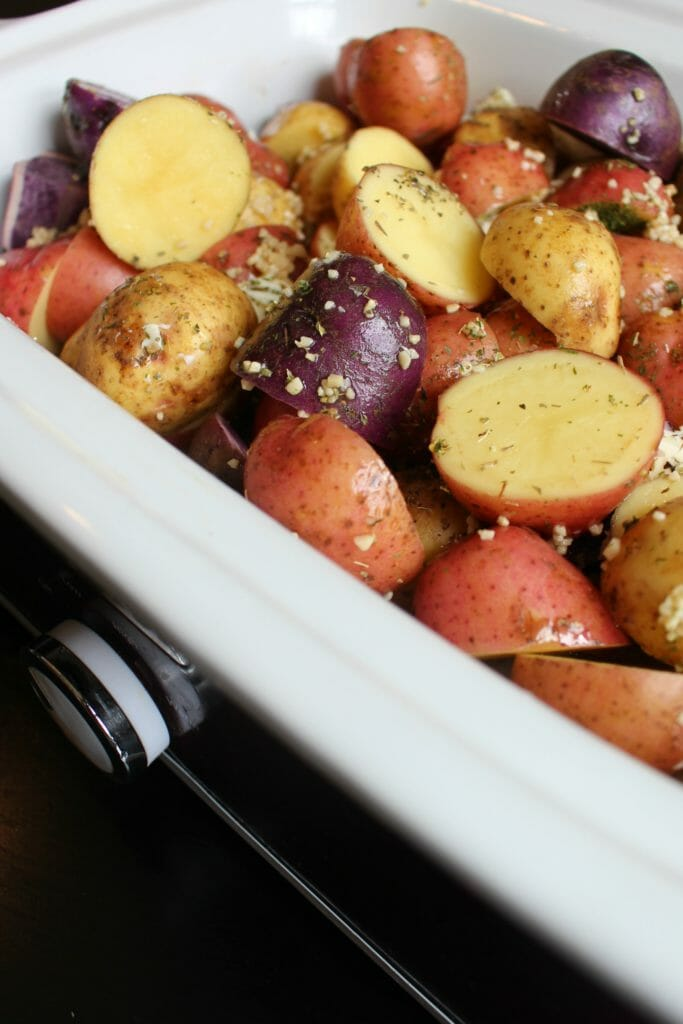Crockpot Herb Garlic Parmesan Potatoes are a beautiful and EASY side dish for Thanksgiving or Christmas! Garlicky and buttery, this quick side dish will make your house smell amazing and compliment any meal! #crockpot #slowcooker #Thanksgiving #Christmas #sidedish #potatoes #slowcookersides #crockpotsides #easysidedish