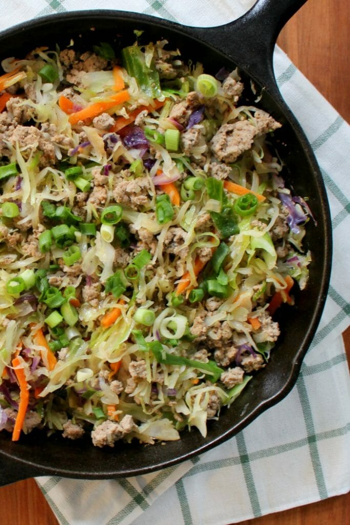 Save time and calories with this easy and delicious Egg Roll Skillet recipe! Serve it on its own in a bowl, over rice, or with noodles for a quick dinner idea!